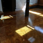 Stained concrete with polyaspartic coating
